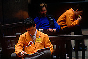 A courier in blue and two traders from the LIFFE futures exchange take a break in the street during a weekday lunchtime in the City of London. Wearing the orange jacket of this once thriving financial instutution, we see a scene of wealth and prosperity, from an era of growth during the industrial revolution to the arrogance and self-indulgence during the government of John Major - a political inheritance from Margaret Thatcher. The LIFFE exchange was synonymous with Thatcherite capitalist money-making ethos in the City of London of the 80s and early 90s before the takeover by Euronext in January 2002. It is currently known as Euronext.liffe. Euronext subsequently merged with New York Stock Exchange in April 2007.