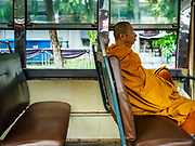 16 AUGUST 2017 - BANGKOK, THAILAND: A Buddhist monk on the number 72 bus in Bangkok.      PHOTO BY JACK KURTZ