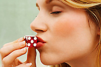 Woman Kissing Dice close up side view