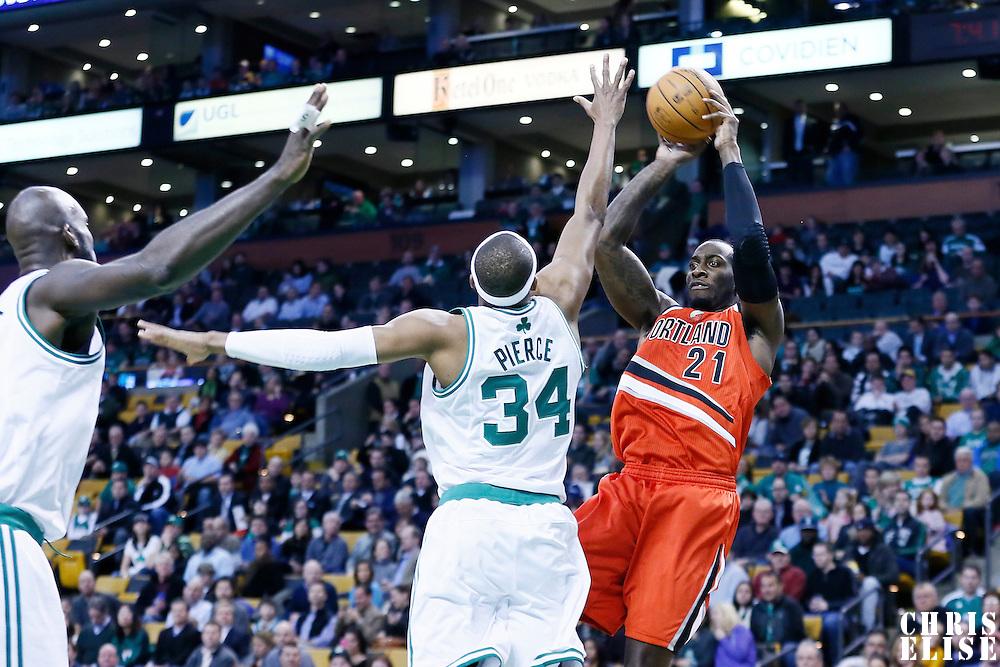 30 November 2012: Portland Trail Blazers center J.J. Hickson (21) passes the ball over Boston Celtics small forward Paul Pierce (34) during the Boston Celtics 96-78 victory over the Portland Trail Blazers at the TD Garden, Boston, Massachusetts, USA.