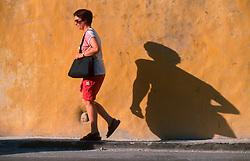 MALTA GOZO VICTORIA JUL00 - A tourist strolls through Victoria.. . jre/Photo by Jiri Rezac. . © Jiri Rezac 2000. . Tel:   +44 (0) 7050 110 417. Email: info@jirirezac.com. Web:   www.jirirezac.com