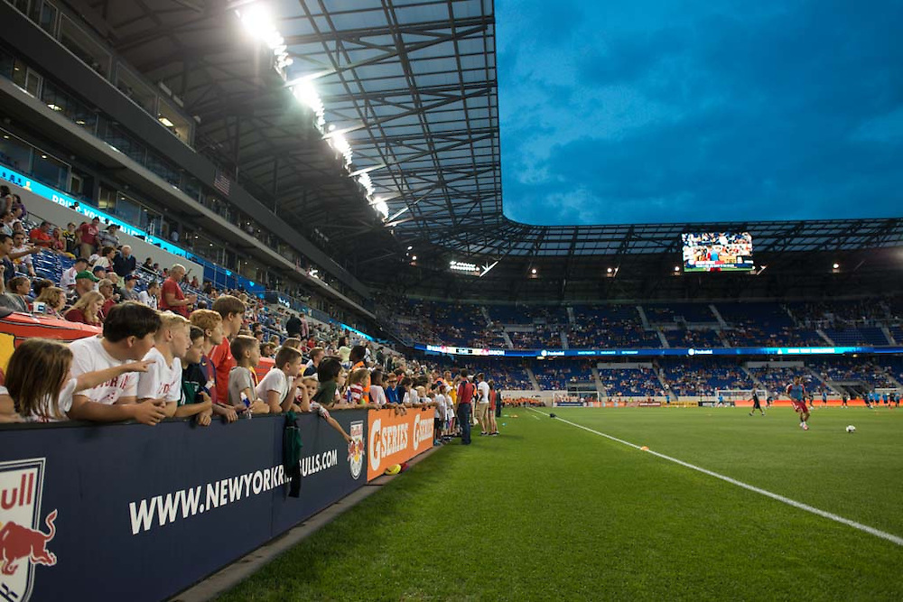 HARRISON, NJ - AUGUST 17:  Young kids watch the warm ups before the game between the New York Red Bulls and the Philadelphia Union at Red Bulls Arena on August 17, 2013. (Photo By: Rob Tringali)