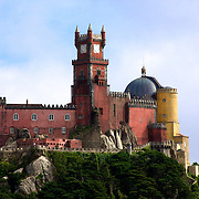 The multicolored and multi-styled Palácio Nacional da Pena - Pena National Palace, situated high above Sintra.