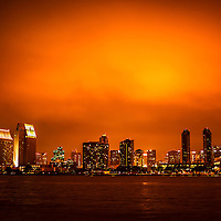 Picture of San Diego cityscape at night with skyscraper office buildings along San Diego Bay. Image is high resolution and was taken in 2012.