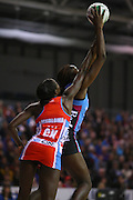 Steel's Jhaniele Fowler gets the ball ahead of Swifts Sonia Mkoloma in the ANZ netball championship match, Stadium Southland Velodrome, Invercargill, New Zealand, Monday, May 06, 2013. Credit:NINZ/Dianne Manson