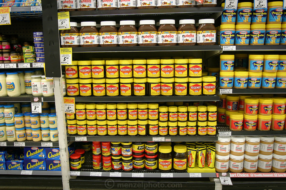 Much Australian food is similar to the foods found in Europe or the U.S. But some are distinctly Australian, including, notoriously, the yeast-extract spreads shown here. The most famous of these is Vegemite, bought by Kraft from its Australian creators. Other brands include the locally manufactured Mightymite and Promite (a sweeter version). Some Australians still hold out for Marmite, the British original. Hungry Planet: What the World Eats (p. 34).  This image is featured alongside the Molloy family images in Hungry Planet: What the World Eats.