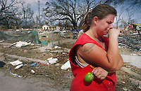 Photo by Jon M. Fletcher / Staff - 83105 - Grasping a fresh lime she found ripening on a friend's tree, Kelly Grisham crys remembering what was swept away by Hurricane Katrina.<br /> &quot;It's just wiped us off the map,&quot; she said.