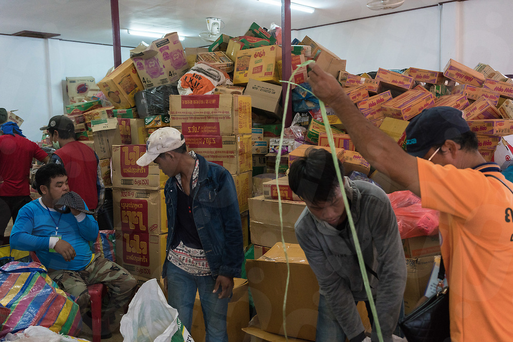 August 05, 2018 - Attapeu (Laos). Food supplies are stacked inside a governmental building in Sanamxai's district. Most of the villages are still cut off by the flood waters and only reachable by air or after a dangerous drive by 4x4 vehicles and tractors © Thomas Cristofoletti / Ruom