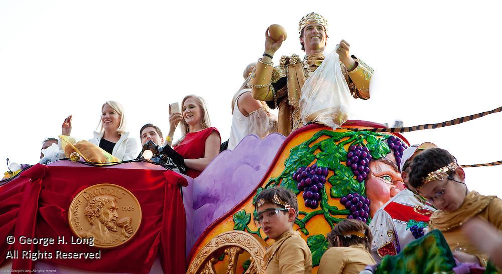 New Orleans Saints quarterback Drew Brees rides as King in Bacchus Mardi Gras parade