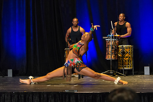 A dancer from Step Afrika! African American Dance Company performs as drummers play in the background at the Annual Jazz Brunch.