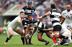 Charles Piutau of the Barbarians looks to offload the ball after being tackled - Mandatory byline: Patrick Khachfe/JMP - 07966 386802 - 02/06/2019 - RUGBY UNION - Twickenham Stadium - London, England - England XV v Barbarians - Quilter Cup International