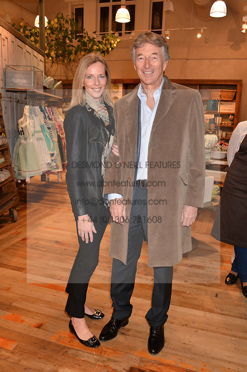 STUART CROSSLEY and his wife VICTORIA at a party to celebrate the publication of 'Inspire: The Art of Living With Nature' by Willow Crossley held at Anthropologie, 131-141 Kings Road, London on 13th March 2014.