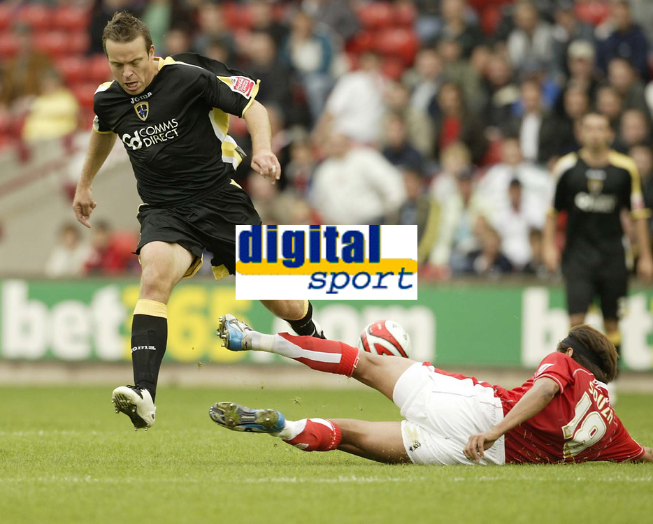 Photo: Aidan Ellis.<br /> Barnsley v Cardiff City. Coca Cola Championship. 29/09/2007.<br /> Cardiff's Gavin Rae loses out to Barnsley's Dennis Souza