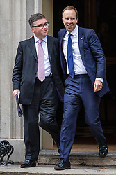 © Licensed to London News Pictures. 16/10/2019. London, UK. Secretary of State for Justice Robert Buckland (L) and Secretary of State for Health and Social Care Matt Hancock (R) leave 10 Downing Street after the Cabinet meeting. Photo credit: Rob Pinney/LNP