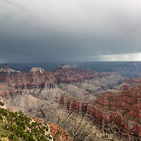Double lightning bolts strike over the Grand Canyon, as seen from the North Rim, Grand Canyon National Park, Arizona
