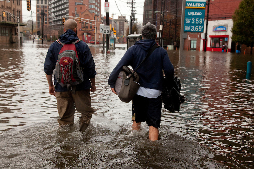 Resident of Hoboken NJ struggle with floods street after Hurricane Sandy hit Jersey city Tuesday October 30, 2012.