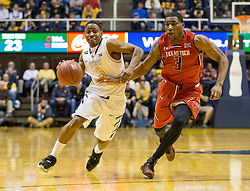 West Virginia Mountaineers guard Juwan Staten (3) drives past a defender against the Texas Tech Red Raiders during the first half at the WVU Coliseum.