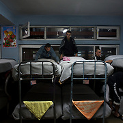 November 14, 2012 - Kabul, Afghanistan: Afghan National Police (ANP) cadets tide their beds in the early hours of the morning at the Afghan Nacional Police Academy...ANP Academy trains 1250 cadets at the time during a period of four years. Every year, five hundred new recruits are selected, out of more than nine thousand of candidates, to join the academy and other five hundred graduate. Fifteen per cent of the recruits are women. (Paulo Nunes dos Santos)