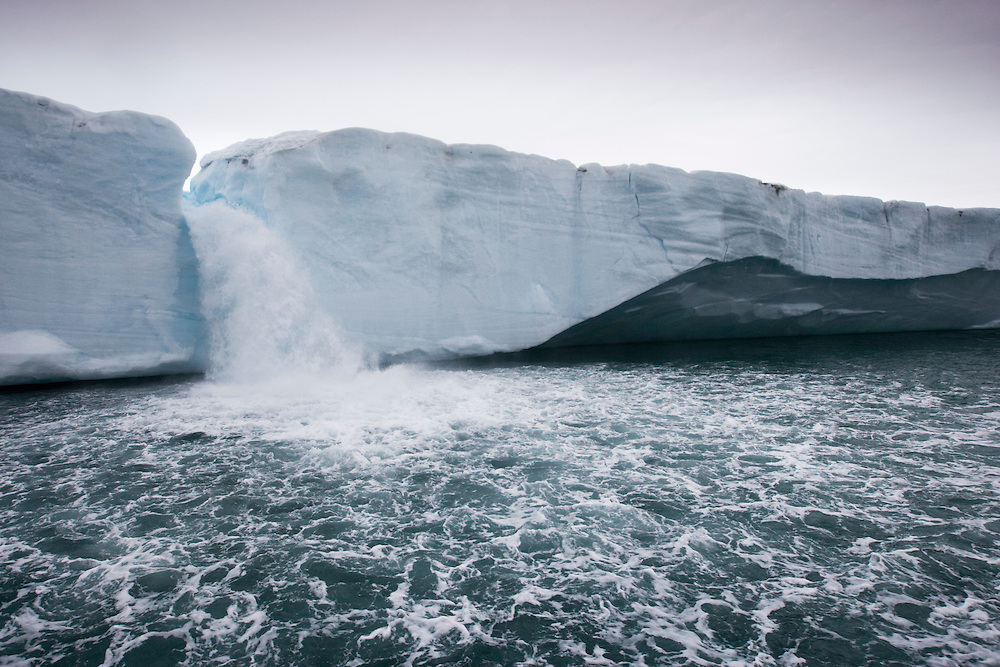 Norway, Svalbard, Nordaustlandet, Melting water pours from ice face of Brasvellbreen Icefield on stormy summer morning