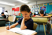 URANIUM CITY, SK - 08/10/08 -  Seven-year-old Riley concentrates on his school-work at Ben MacIntyre School in Uranium City Saskatchewan.