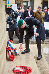 © Licensed to London News Pictures. 03/02/2018. LONDON, UK.  Justice of Northern Ireland Veterans laying wreathes at the Cenotaph during a parade through central London. The organization is campaigning against the prosecutions of army personnel for actions during the Troubles in Northern Ireland.  Photo credit: Cliff Hide/LNP