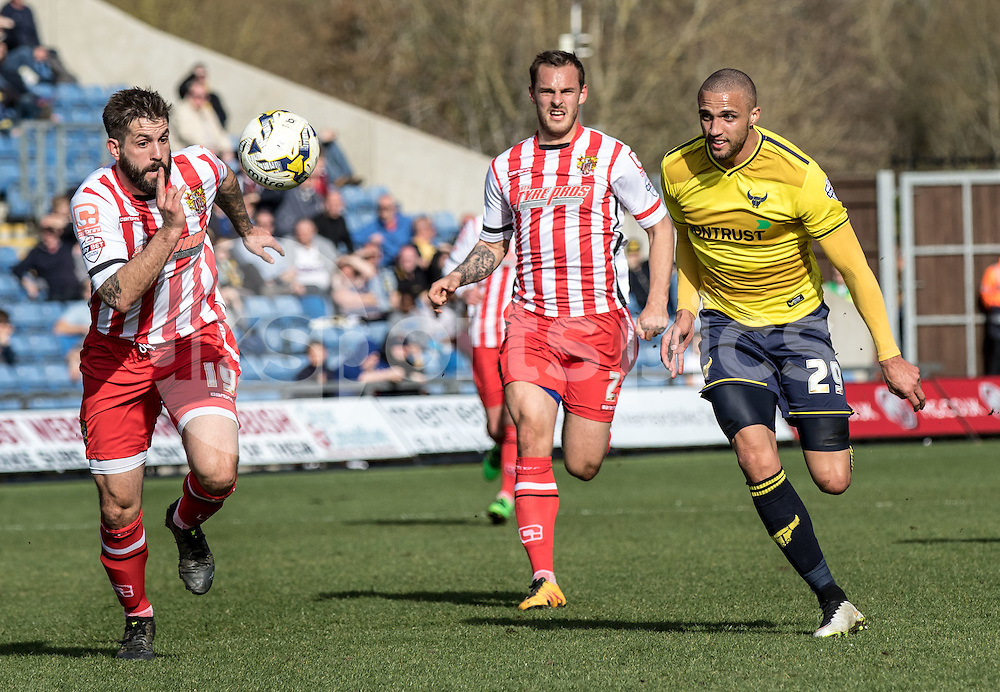 Dean Wells of Stevenage and Jordan Bowery of Oxford United chase down the ball during the Sky Bet League 2 match between Oxford United and Stevenage at the Kassam Stadium, Oxford, England on the 25th March 2016. Photo by Liam McAvoy.