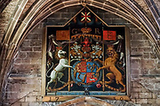 "In a large painting in St Giles' Cathedral, a Scottish unicorn paired with an English lion defines the coat of arms of James VI, as the first king of Great Britain and Ireland. What's with the unicorn? Unicorns were first depicted in 2600 BC in ancient seals of the Indus Valley Civilization and were mentioned by the ancient Greeks. In Celtic mythology the unicorn symbolized purity, innocence, masculinity and power. The proud, haughty unicorn was chosen as Scotland's national animal because it would rather die than be captured, just as Scots would fight to remain sovereign and unconquered. The unicorn was first used on the Scottish royal coat of arms by William I in the 1100s, and two unicorns supported the shield until 1603. When James VI became James I of England and Ireland in 1603, he replaced one unicorn with the national animal of England, the lion, to demonstrate unity. Believed to be the strongest of all animals, wild and untamed, the mythical unicorn could only be humbled by a virgin maiden. However, Scotland's unicorn in the coat of arms is always bounded by a golden chain, often shown around its neck and body, symbolizing the power of the Scottish kings, strong enough to tame a unicorn. Today, the version of the royal coat of arms used in Scotland emphasizes Scottish elements, placing the unicorn on the left and giving it a crown, whereas the version used in England and elsewhere places the unicorn on the right and gives English elements more prominence. The Scottish version uses the motto ""Nemo me impune lacessit,"" meaning ""No one wounds (touches) me with impunity."" The English version says ""Dieu et mon droit,"" meaning ""God and my right,"" the motto of the Monarch of the United Kingdom. St Giles' Cathedral (High Kirk of Edinburgh) is the principal place of worship of the Church of Scotland in Edinburgh."