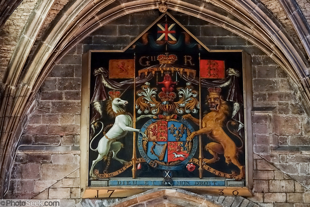 """In a large painting in St Giles' Cathedral, a Scottish unicorn paired with an English lion defines the coat of arms of James VI, as the first king of Great Britain and Ireland. What's with the unicorn? Unicorns were first depicted in 2600 BC in ancient seals of the Indus Valley Civilization and were mentioned by the ancient Greeks. In Celtic mythology the unicorn symbolized purity, innocence, masculinity and power. The proud, haughty unicorn was chosen as Scotland's national animal because it would rather die than be captured, just as Scots would fight to remain sovereign and unconquered. The unicorn was first used on the Scottish royal coat of arms by William I in the 1100s, and two unicorns supported the shield until 1603. When James VI became James I of England and Ireland in 1603, he replaced one unicorn with the national animal of England, the lion, to demonstrate unity. Believed to be the strongest of all animals, wild and untamed, the mythical unicorn could only be humbled by a virgin maiden. However, Scotland's unicorn in the coat of arms is always bounded by a golden chain, often shown around its neck and body, symbolizing the power of the Scottish kings, strong enough to tame a unicorn. Today, the version of the royal coat of arms used in Scotland emphasizes Scottish elements, placing the unicorn on the left and giving it a crown, whereas the version used in England and elsewhere places the unicorn on the right and gives English elements more prominence. The Scottish version uses the motto """"Nemo me impune lacessit,"""" meaning """"No one wounds (touches) me with impunity."""" The English version says """"Dieu et mon droit,"""" meaning """"God and my right,"""" the motto of the Monarch of the United Kingdom. St Giles' Cathedral (High Kirk of Edinburgh) is the principal place of worship of the Church of Scotland in Edinburgh."""