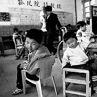 BIAN VILLAGE, 14 APRIL 2001: orphans play in a catholic owned orphanage in Bian village. China cut relations with the Vatican in the early fifites and since then, established a Patriotic catholic Church that's controlled by Chinese authorities.<br />Catholics who refused to give up their ties with the Vatican, started worshipping in underground churches and consequently were persecuted for a long time. Since the late nineties though, relations with the Vatican informally started to improve. Although China still has no diplomatic relations, many representatives from official churches met the pope John Paull II secretely . The Vatican, under the pope's leadership, has made several efforts to recover the tie with China. In February 2006 , Hong Kong Bishop Joseph Zen was named one of the first 15 new cardinals, which is seen by many as a gesture of goodwill and a significant step towards recovering the Vatican-China relationship.