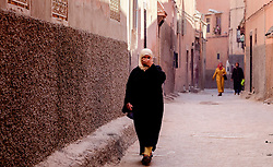 Women in traditional dress walking in the medina in Marrakech, Morocco, North Africa<br /> <br /> <br /> (c) Andrew Wilson | Edinburgh Elite media