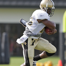 31 July 2009: New Orleans Saints running back Reggie Bush (25) runs with the ball during the opening day of New Orleans Saints training camp held at the team's practice facility in Metairie, Louisiana.
