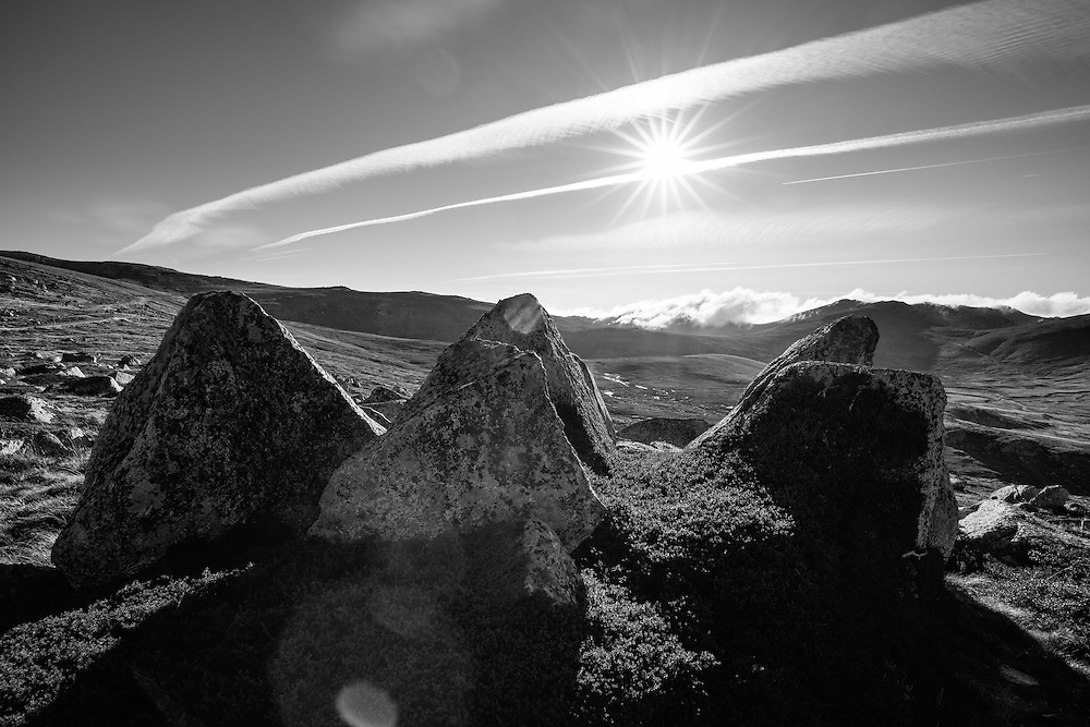 Three backlit triangluar rocks along the Main Range Track. Kosciuszko National Park.