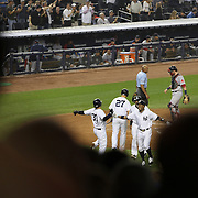 Curtis Granderson, New York Yankees, celebrates with Nick Swisher at home plate after hitting the first of his two home runs during the New York Yankees V Boston Red Sox Baseball game which the Yankees won 14-2 to become American League East champions at Yankee Stadium, The Bronx, New York. 4th October 2012. Photo Tim Clayton