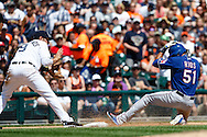 May 25, 2014; Detroit, MI, USA; Texas Rangers right fielder Alex Rios (51) slides into third safe ahead of the throw to Detroit Tigers third baseman Nick Castellanos (9) after he hits a two RBI triple in the fifth inning at Comerica Park. Mandatory Credit: Rick Osentoski-USA TODAY Sports