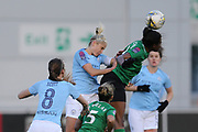 Manchester City Women's defender Steph Houghton (6) and Brighton Womens forward (9) Ini Umotong contest an aerial ball during the FA Women's Super League match between Manchester City Women and Brighton and Hove Albion Women at the Sport City Academy Stadium, Manchester, United Kingdom on 27 January 2019.