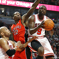24 March 2012: Chicago Bulls small forward Luol Deng (9) goes for the layup past Toronto Raptors power forward Ed Davis (32) during the Chicago Bulls 102-101 victory in overtime over the Toronto Raptors at the United Center, Chicago, Illinois, USA.