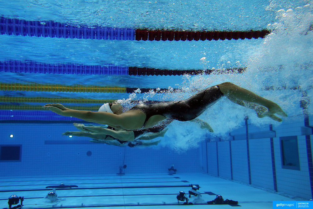 an underwater view of the start of the womens 200m backstroke heats at the aquatic centre - Olympic Swimming Pool Underwater