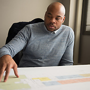 Former NBA player Devean George poses for a video crew from The Players' Tribune with plans for his The Commons at Penn development at his office in the Excelsior Tech Center in Hopkins, Minn. on April 3, 2018. (Photo by Angela Jimenez/The Players' Tribune)