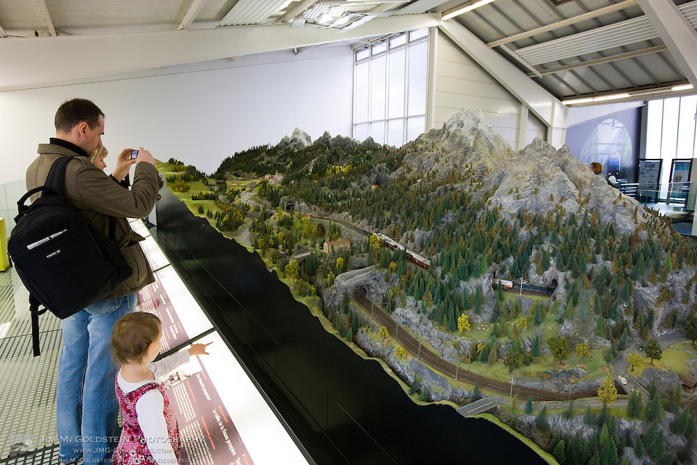 A family views a large model train diorama at the Swiss Museum of Transport in Lucerne, Switzerland