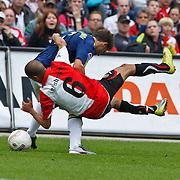 NLD/Rotterdam/20100919 - Voetbalwedstrijd Feyenoord - Ajax 2010, Mounir El Hamdaoui in duel met Karim El Ahmadi