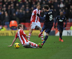 Stoke City's Glenn Whelan tackles Manchester United's Juan Mata - Photo mandatory by-line: Alex James/JMP - Tel: Mobile: 07966 386802 01/02/2014 - SPORT - FOOTBALL - Britannia Stadium - Stoke-On-Trent - Stoke v Manchester United - Barclays Premier League