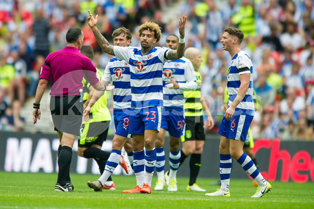 Daniel Williams of Reading argues with Match referee Neil Swarbrick  during the EFL Sky Bet Championship Play-Off Final match between Huddersfield Town and Reading at Wembley Stadium, London, England on 29 May 2017. Photo by Salvio Calabrese.