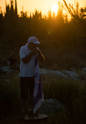An Israeli senior rests his head in his hands, lost in thought, at a joint funeral for the three Israeli teens at a cemetery in Modi'in near Jerusalem, on July 1, 2014. The three Israeli teens whose bodies were found Monday evening were brought to rest side by side on Tuesday at a joint funeral held in Modi'in near Jerusalem. Tens of thousands of people participated in the funeral, including Prime Minister Benjamin Netanyahu and President Shimon Peres, who eulogized the three, whose caskets were wrapped with Israeli flags. EXPA Pictures © 2014, PhotoCredit: EXPA/ Photoshot/ Li Rui<br /> <br /> *****ATTENTION - for AUT, SLO, CRO, SRB, BIH, MAZ only*****