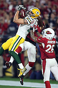 Arizona Cardinals cornerback Patrick Peterson (21) and Arizona Cardinals free safety Rashad Johnson (26) leap while trying to break up a 41 yard Hail Mary pass caught by Green Bay Packers wide receiver Jeff Janis (83) for a touchdown that ties the score at 20-20 with no time left on the game clock, sending the game into overtime during the NFL NFC Divisional round playoff football game against the Green Bay Packers on Saturday, Jan. 16, 2016 in Glendale, Ariz. The Cardinals won the game in overtime 26-20. (©Paul Anthony Spinelli)