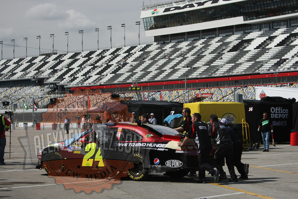 Sprint Cup Series driver Jeff Gordon (24) gets a push through the garage area at Daytona International Speedway on February 18, 2011 in Daytona Beach, Florida. (AP Photo/Alex Menendez)