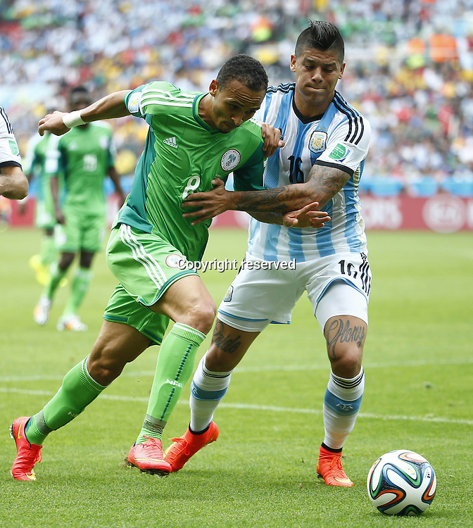 25.06.2014. Porto Alegre, Brazil.  Nigerias Peter Osaze Odemwingie (L) with Argentina s MarcRojo during a Group F match between Nigeria and Argentina of 2014 FIFA World Cup at the Estadio Beira-Rio Stadium in Porto Alegre, Brazil, on June 25, 2014.