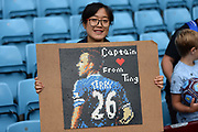A young Chinese Girl from Beijing waits to present John Terry with a picture of himself made from Lego Bricks during the EFL Sky Bet Championship match between Aston Villa and Norwich City at Villa Park, Birmingham, England on 19 August 2017. Photo by Dennis Goodwin.