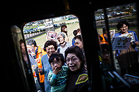 Locals on the island of Kyushu come out to the station to see the Seven Stars Kyushu luxury train in Japan.