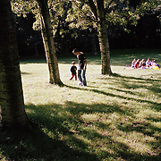 Dutch-Turkish teenager Hakan Dinc plays with his cousin in the Spaarnwoude park on the outskirts of Amsterdam. .Dinc, 16, was born in the Netherlands. His grandparents from his father?s side came from Turkey in 1971, and his mother came in 1987. Dinc feels more Turkish than Dutch, most of his friends are Turkish and he wants to marry a Turkish girl. During his time off he works in his uncle?s grocery store. Later, he wants to have his own shop. Dinc is following a Commerce course at a vocational school in Amsterdam. .Dinc likes music, pool and chilling out. He has a fourteen-year-old sister and a brother aged ten months. .Picture shot in Amsterdam in 2004 by Justin Jin. .