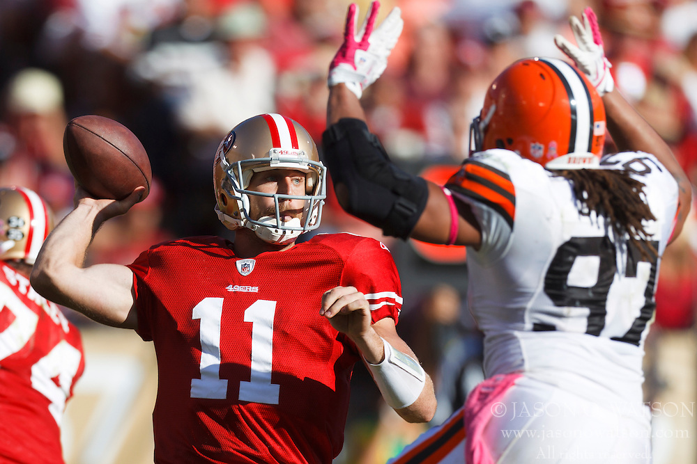 Oct 30, 2011; San Francisco, CA, USA; San Francisco 49ers quarterback Alex Smith (11) passes over Cleveland Browns defensive end Jabaal Sheard (97) during the third quarter at Candlestick Park. San Francisco defeated Cleveland 20-10. Mandatory Credit: Jason O. Watson-US PRESSWIRE